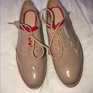 Nude patent loafers